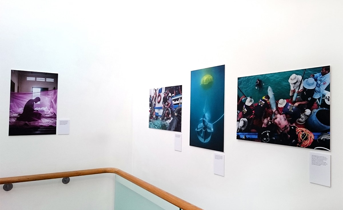 'Dark Water - Cambodia's UXO Salvage Divers' Exhibition by Charles Fox. Lambda C-Type prints produced and mounted on to Foamex by Genesis.